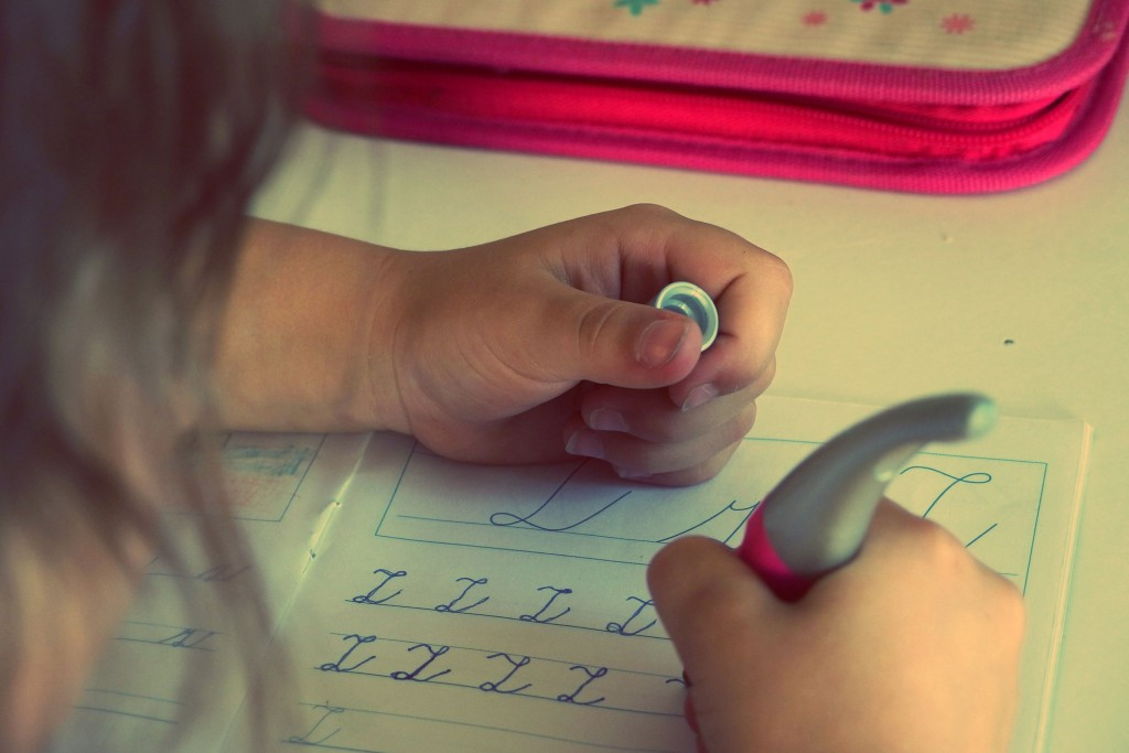 girl practicing cursive